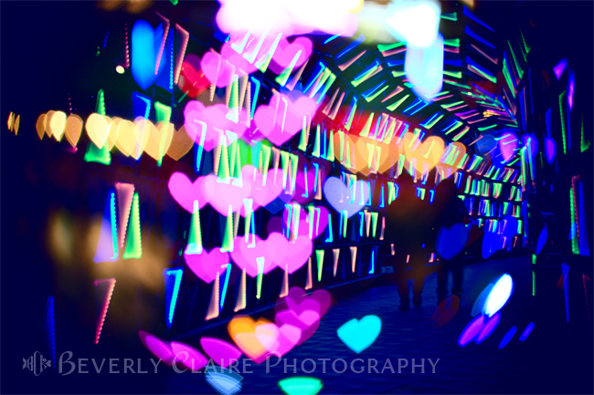 Couple In Colorful Light Tunnel with Hearts and Triangles