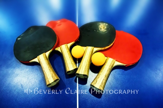 Ping-pong Bats or Table Tennis Paddles on Blue