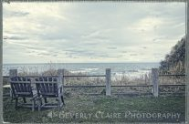 Pair of Wooden Chairs Overlooking Ocean on a Cold Grey Afternoon