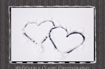 Hearts on Snow with Wood Panel Background