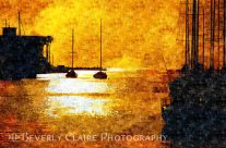 Yacht Silhouettes and Yellow Sunset with Shimmering Sea